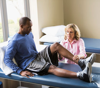 Athlete receiving physical therapy in a sports clinic